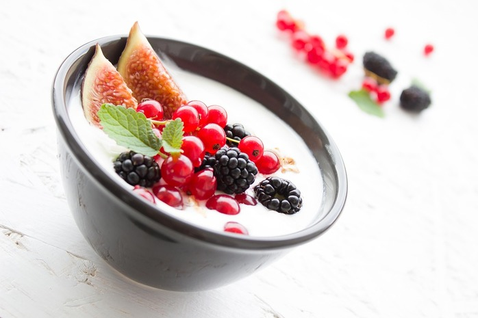 black bowl filled with yogurt and fresh fruit