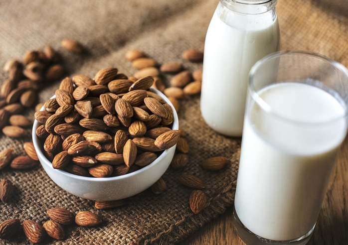 bowl of almonds and 2 glasses of milk