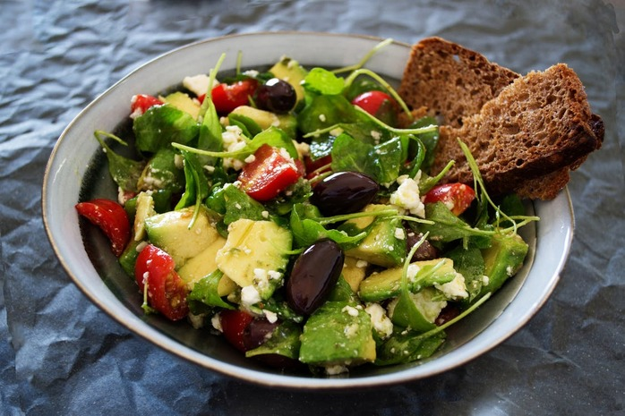 bowl of salad with wheat bread