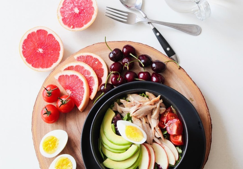 bowl of veggies, boiled egg and fruit 