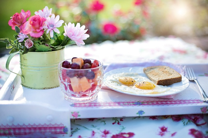 colorful flowers, glass of fruit, eggs & toast
