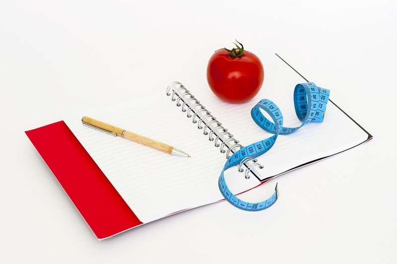 journal, pencil, apple, measuring tape