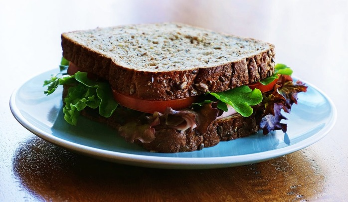 sandwich made with whole wheat bread and veggies