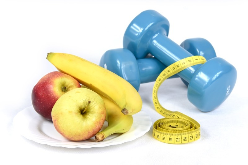 weights, measuring tape, apples, banana