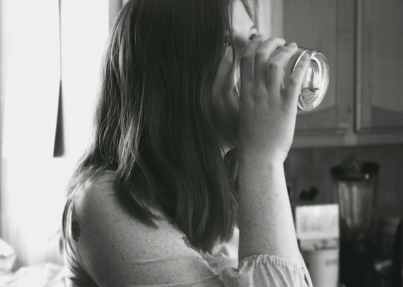 woman drinking water  - Benefits of Drinking Water - Drink Up